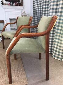 2 x wooden chairs with green upholstered seats and backs.