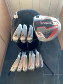 Mizuno golf clubs and cobra amp 5 woods.