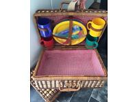 Three Whicker Hampers one with plates and cups