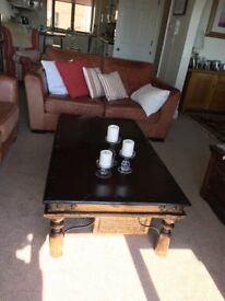 Two dark solid wood coffee tables 136x75x40 and 60x60x40. Indian made.