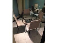 Good condition Ikea glass dining table with 4 chairs