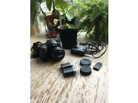 Nikon D7000 16.2 MP Camera with 35mm 1.8G lens, bag and accessories