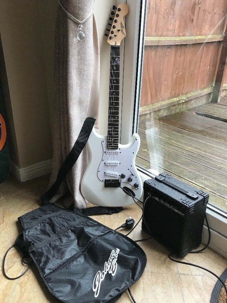 Johnny brook electric guitar with 100watt Amp , A1 condition, Amp lead and guitar cover included.