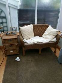 Wicker sofa and cupboard