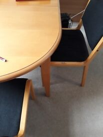 A Pine oval dining table with four chairs