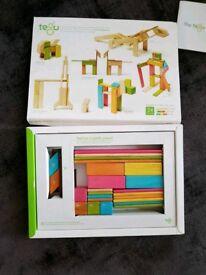 TEGU magnetic wooden blocks 24 piece set multicolor