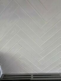 White herringbone tiles