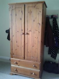 Lovely 2 door pine wardrobe with hanging rail and 2 drawers for sale