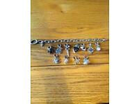Fossil charm bracelet and 11 charms