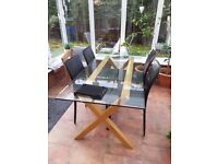 Habitat glass and oak dining table. 180c)mx80cm.
