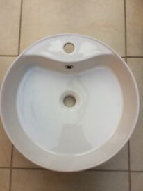 White round ceramic basin