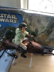 Large Princess Leia figure on speeder bike.