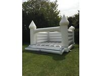 White Adult and Kids Bouncy Castle Hire for Wedding or any other venue.