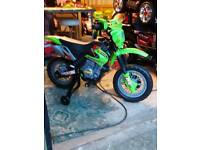 Kids green electric motor bike