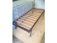 A Single Bed, The Frame Legs Fold + A Single Mattress, Very Clean, Hardly Used At All.