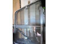 A pair of Van sliding windows