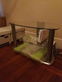 As new - Glass TV table - For collection