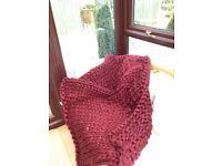 Handmade large wine coloured knit blanket