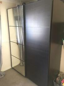 Ikea PAX wardrobes with sliding doors.