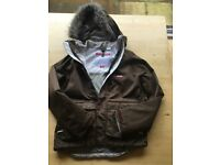 Ladies designer ski jacket brown pinstripe. Fur on the hood.snow skirt