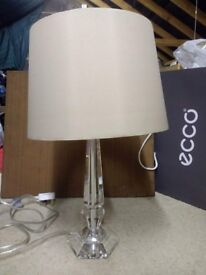 Attractive glass stemmed table lamp.
