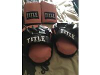 Boxing gloves and punching pads set.