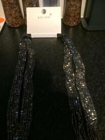 M and s silver necktie
