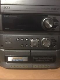 Triple CD stereo in good condition, including a record player and speaker