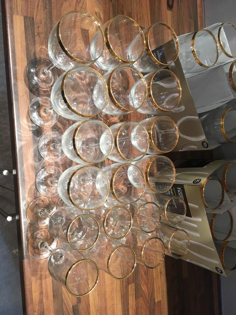 Set of gold rimmed glassss