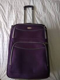 Large Samsonite purple suitcase