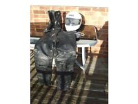 leather trousers and boots and helmet