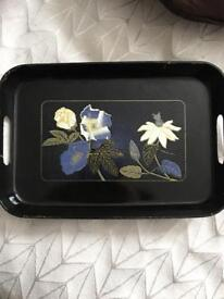 Black tray with floral design.