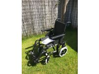 Invacare Action 2NG Lightweight Foldable Transit wheelchair with padded cushion