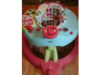Mama & Papas Baby walker with Activity playtable around top of it.