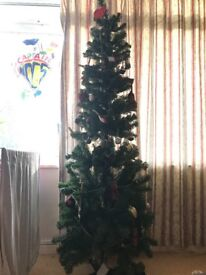 Christmas tree with lights and decorations for sale