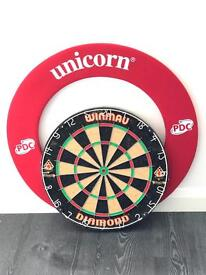 Used Dart board and matching foam protective surround.
