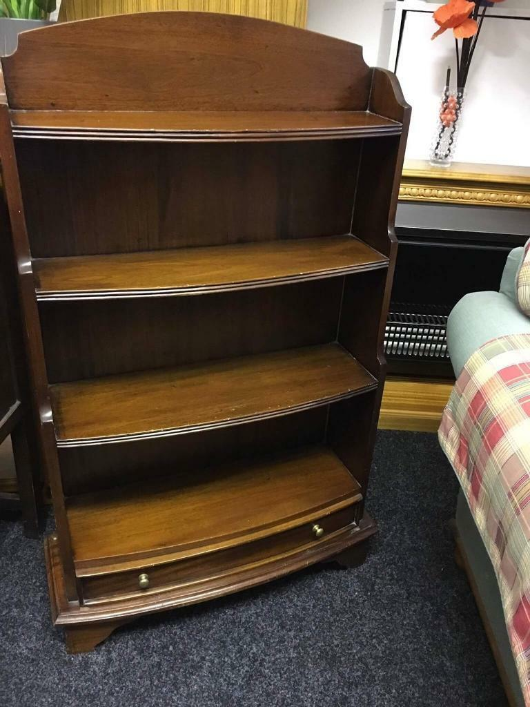 Dark wood bookcase can deliver