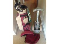 5 golf clubs, golf bag and trolley.