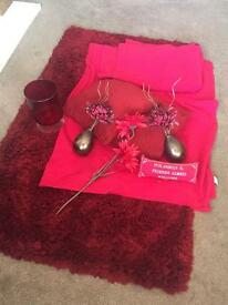Red rug, throws, cushions and accessories