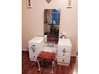 Old vintage dressing table with mirror and stool painted in white