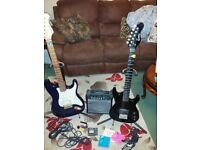 Electric guitars x2 with amp stands tuner cables etc