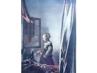 Girl Reading a Letter at an Open Window by Dutch painter Johannes Vermeer
