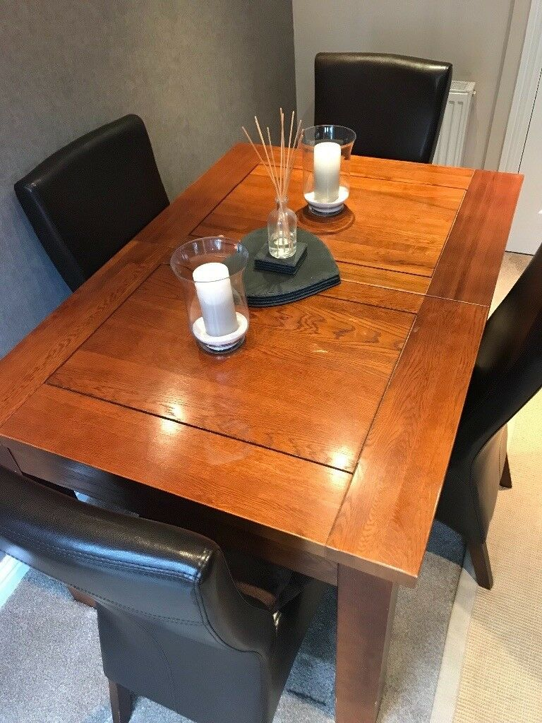 Solid wood extendable dining table and 4 leather chairs ...