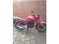 Red Honda 125CBF, 3900 mileage, really good condition