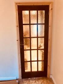 Two wooden glazed internal doors for sale