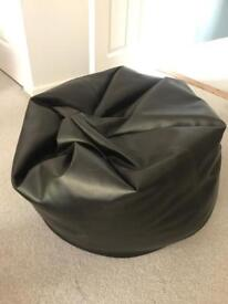 Black faux leather bean bag in good condition