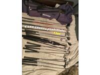 Golf bag, clubs, tees, balls and an umbrella