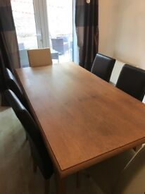 Solid wooden dining table with 6 leather chairs