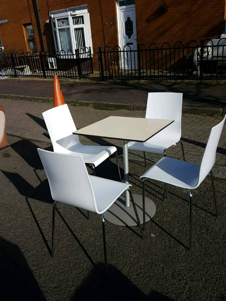 Table and 4 white chairs belfast