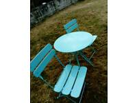 Blue metal fold up bistro to table and 2 chairs